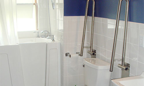 movable grab bars around a toilet