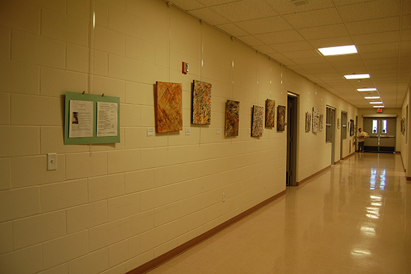 Amherst Senior Center hallway with paintings hanging