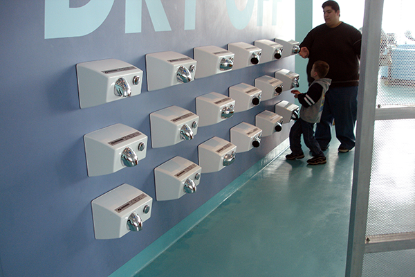 exhibit display at the of hand dryer mounted on a wall at different heights