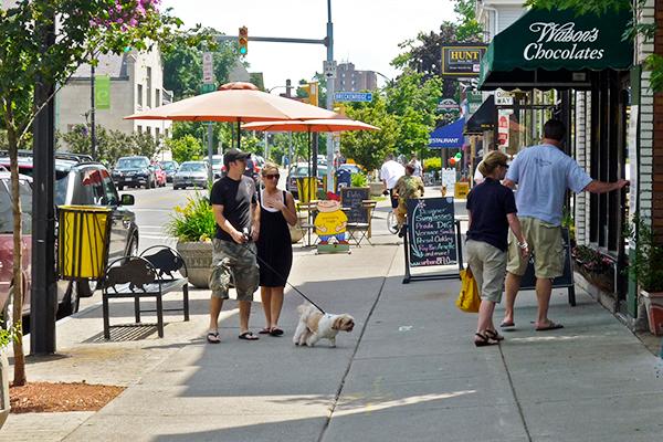 people walking along elmwood ave sidewalk in Buffalo, New York