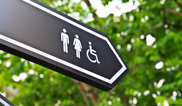Wayfinding sign showing direction of restrooms