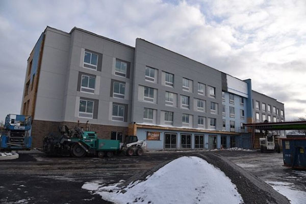 Hampton by Hilton construction image of exterior - Uniland Development