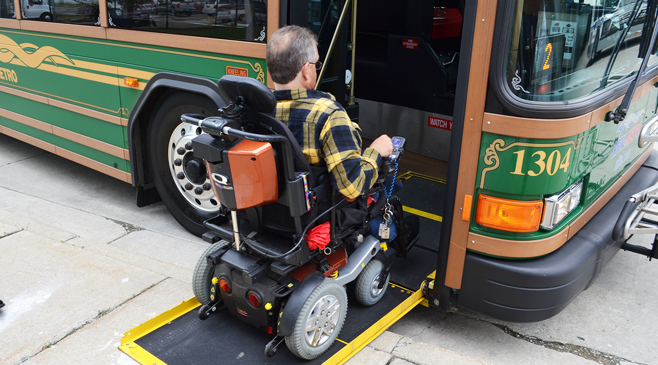 Wheelchair user embarking onto a bus