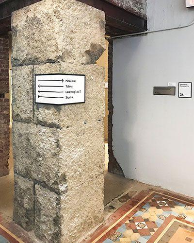 wayfinding signage on post
