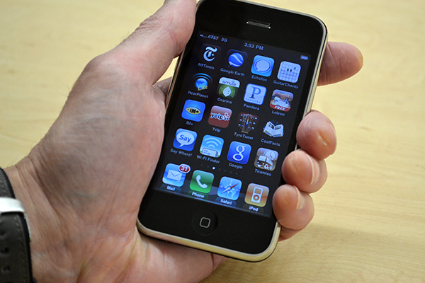 closeup of an iphone screen showing multiple apps