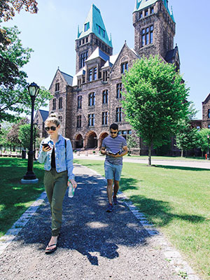 Two individuals walking along the Richard's Olmsted
