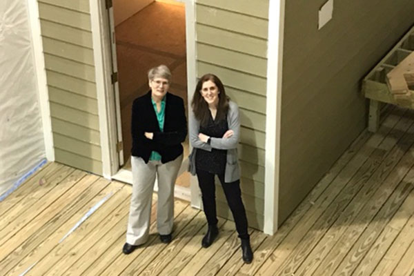 Researchers standing at the front entrance of HIL housing mockup