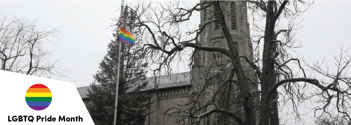 LGBTQ flag flying infront of church
