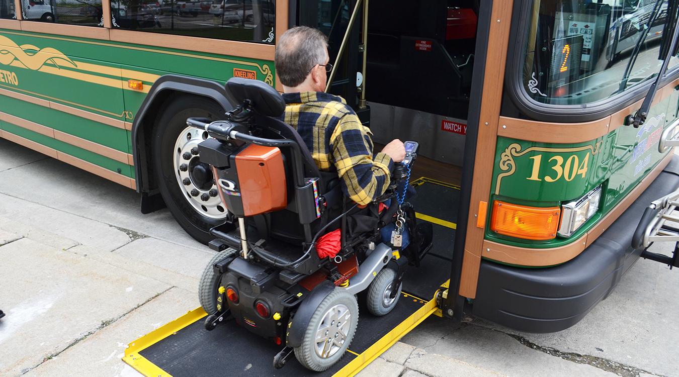 Wheelchair user embarking onto a bus
